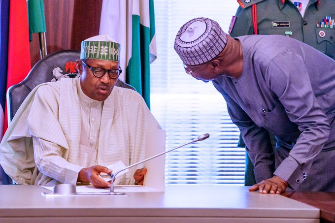 Boss Mustapha, with President Buhari: foreign travels banned