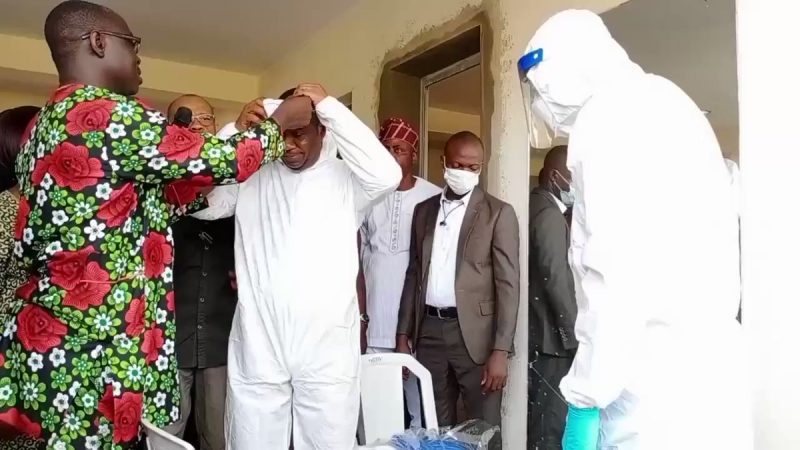 Governor sanwo-Olu, rights, waits as deputy Hamzat is kitted with coronavirus protective kit