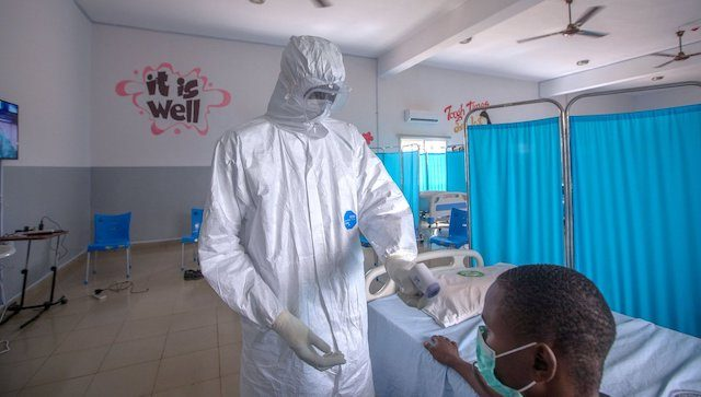 A medical officer and a COVID-19 patient in Nigeria