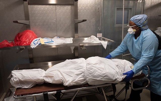 A COVID-19 patient wrapped for burial
