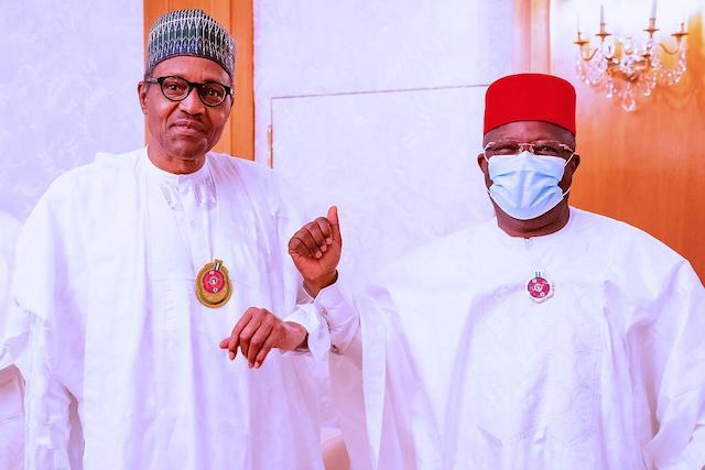 Buhari and Umahi greet