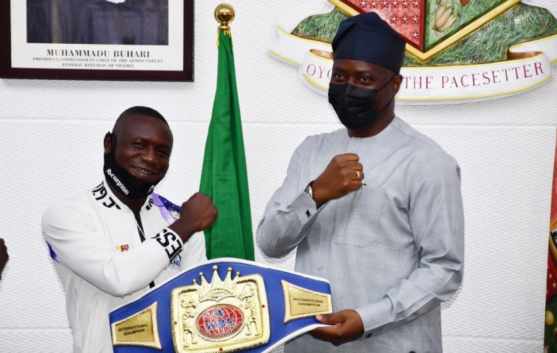 Seyi Makinde and the boxing champ called scorpion