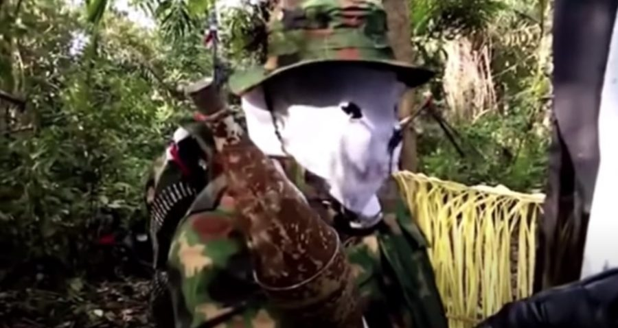 Masked Niger Delta militant making the threat of attacks on Tuesday