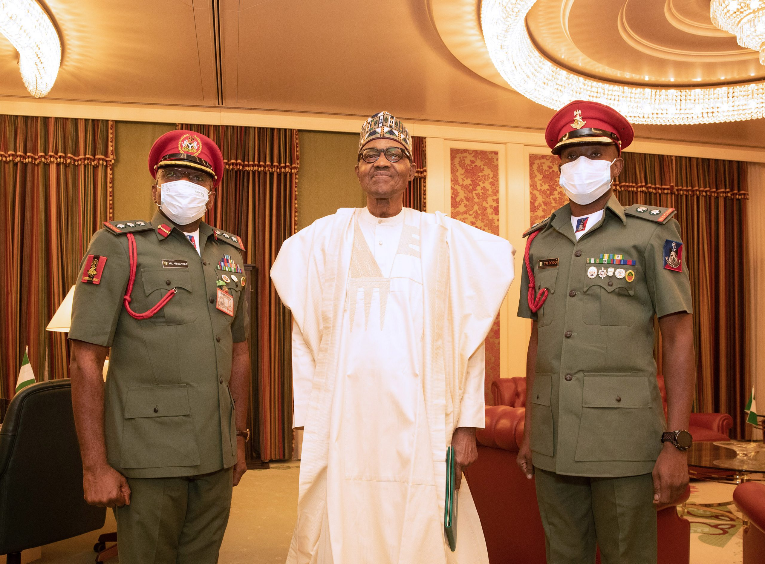PRESIDENT BUHARI WITH THE OUTGOING ADC AND INCOMING ADC 2