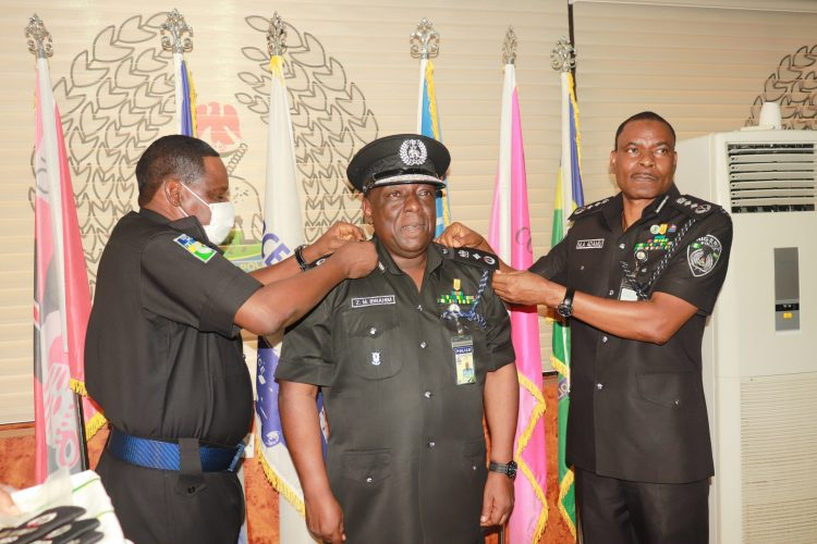 The IGP alongside DIG Training decorating DIG Zanna Ibrahim, mni with his new rank
