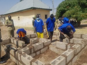 Some inmates at the Billiri Correctional Centre undergoing training on building