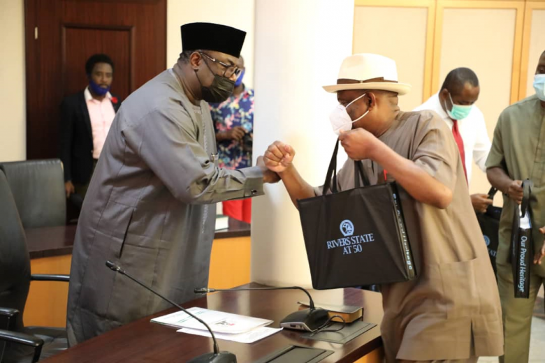 Governor of Rivers State, Nyesom Ezenwo Wike (right) presents a souvenir to the Minister of State for Agriculture and Rural Development, Hon. Mustapha Baba Shehuri during the latter's courtesy visit to the Government House, Port Harcourt on Monday, 15th of March 2021.