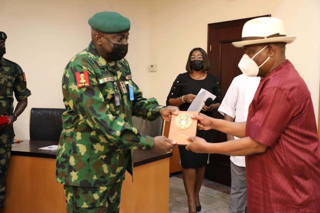 Governor  Wike (right) receives  a plaque from COAS, Lt. General Ibrahim Attahiru during the latter's courtesy call  at the Government House, Port Harcourt on Tuesday. Wike tells Attahiru that his predecessor, Tukur Buratai, was grossly partisan