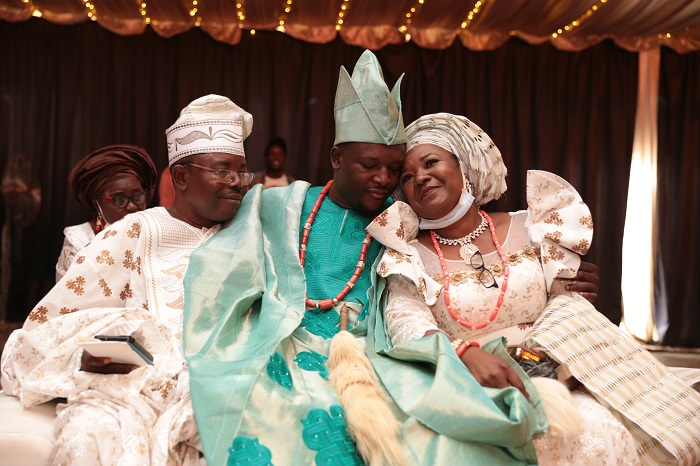 Oba Malaolu with his parents