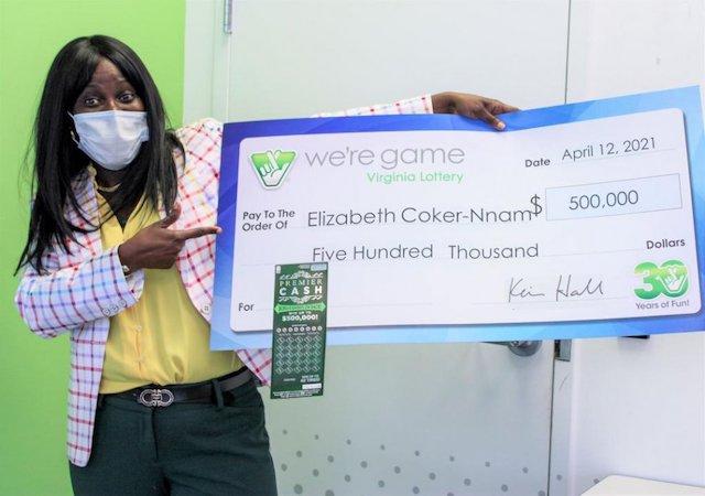 Elizabeth Tutu Coker-Nnam with her prize check.