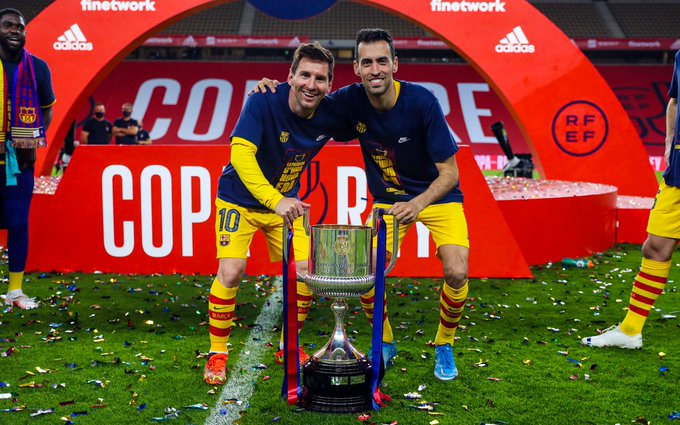 Messi and another team mate with the Copa del Rey