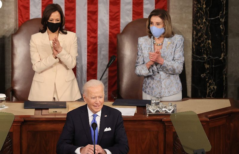VP Kamala Harris and Speaker Nancy Pelosi cheer President Biden
