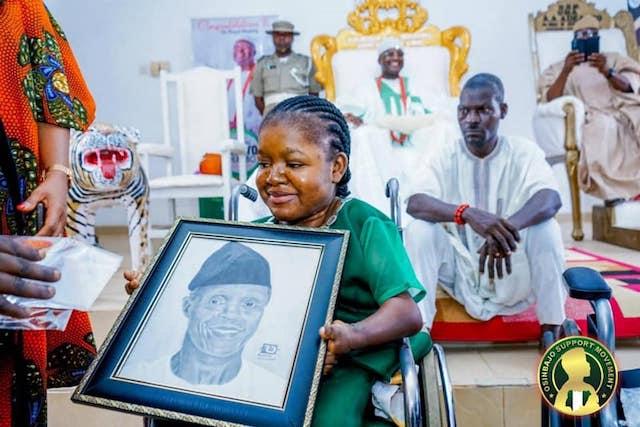 Abosede Okeowo with pencil portrait of VP Yemi Osinbajo