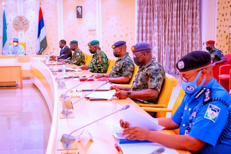 Buhari with service chiefs during the security meeting in Abuja