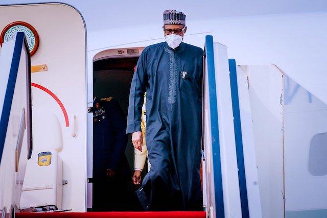Buhari back home from Paris