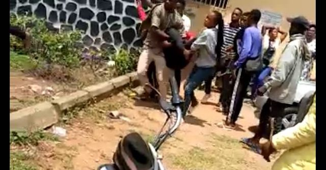 One of the students of the College of Health Technology Ijero-Ekiti being carried by others to the hospital