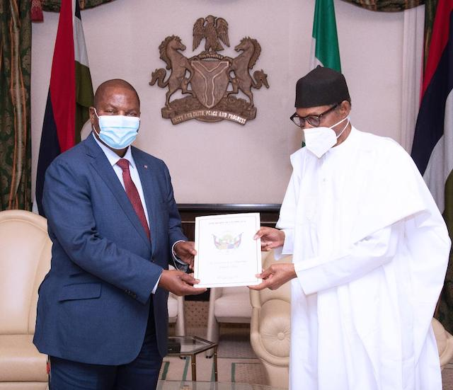President of Central African Republic (CAR) H.E Prof Faustine Archange Touadera presents a letter to Buhari
