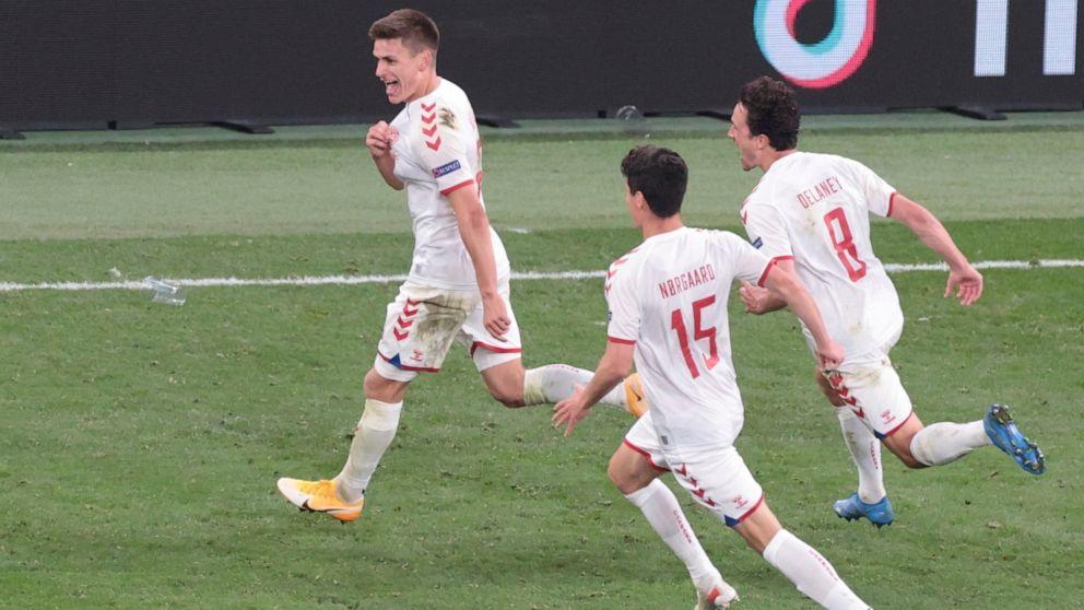 Denmark's Joakim Maehle celebrates Denmark's 4th goal against Russia