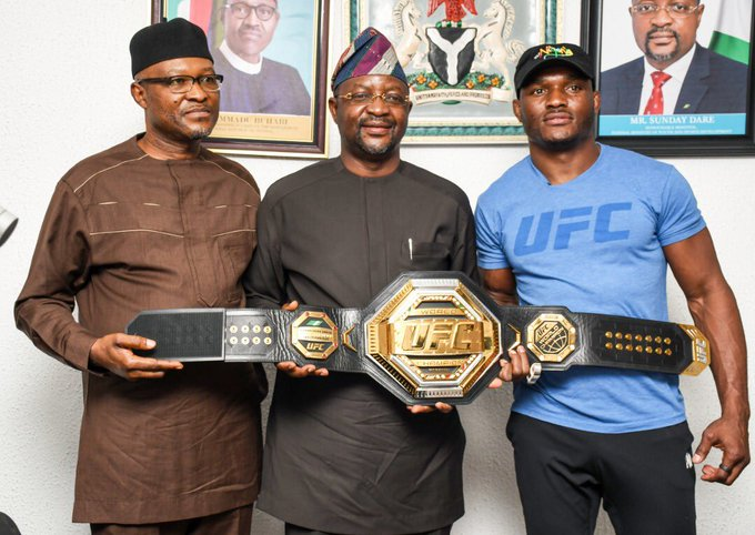 Kamaru Usman, right with Sports minister Sunday Dare(middle0