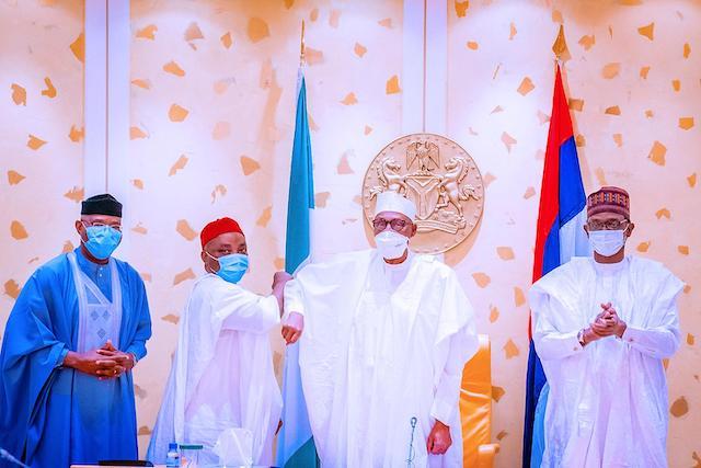 Nwaoboshi, secondd left being welcomed into APC by Buhari. Left is Senator Ovie Omo-Agege and right Governor Mai Mala Bunu