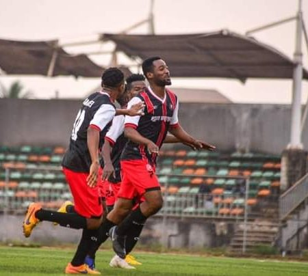 Abia Warriors players celebrate after a goal