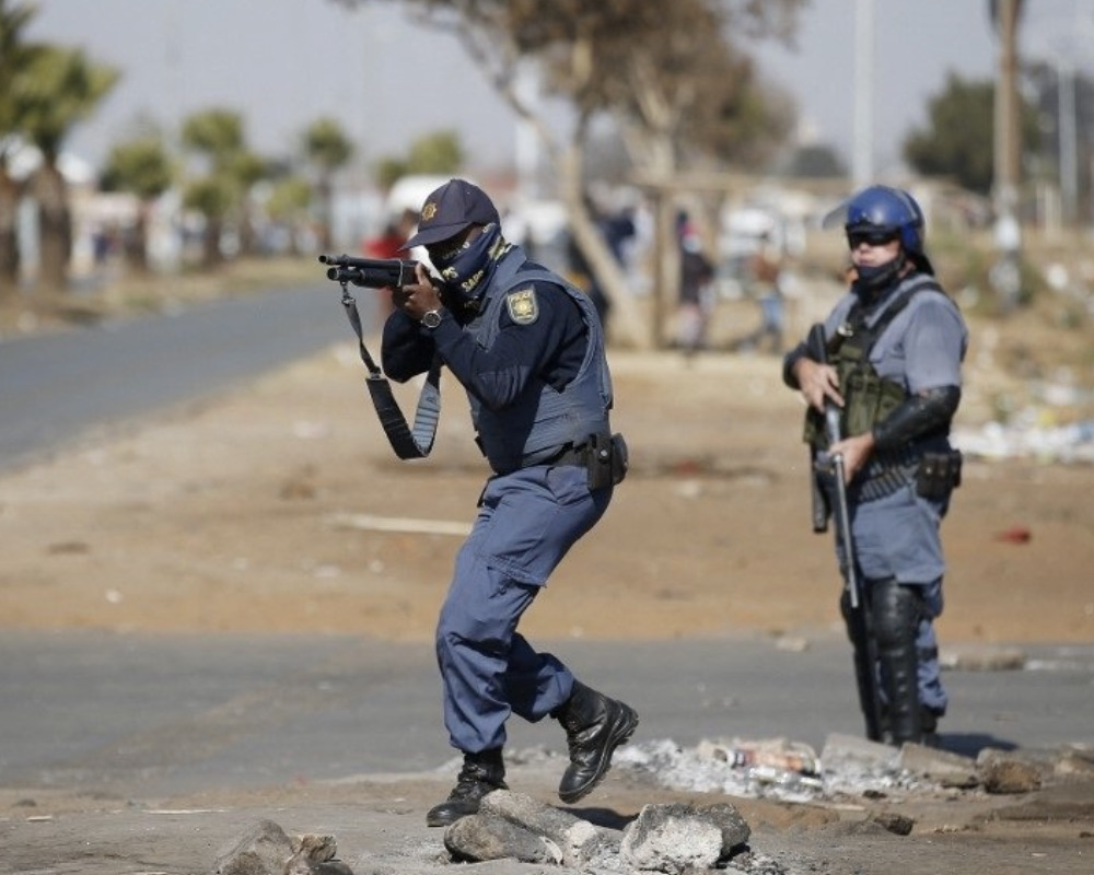 South Africa policemen target rioters