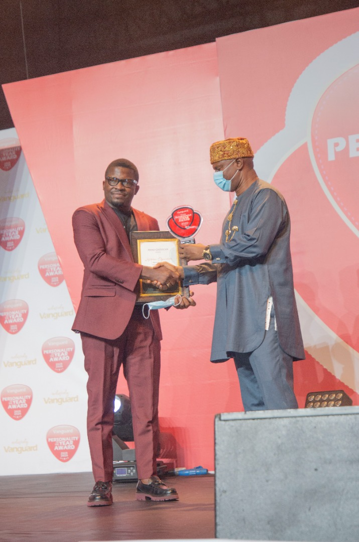 Sijibomi Ogundele receiving his award at the Eko Hotel and Suites, Lagos in a grand ceremony
