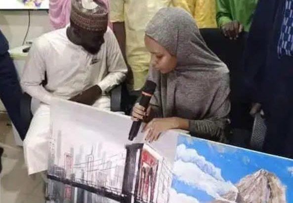 Amina Abdullahi with her paints