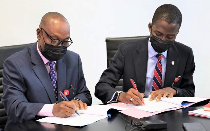 Executive Chairman, Economic and Financial Crimes Commission (EFCC), Abdulrasheed Bawa and Nigeria Extractive Industries Transparency Initiative (NEITI) led by its Executive Secretary, Dr. Orji Ogbonnaya Orji during the signing of a Memorandum of Understanding (MoU), between the EFCC and NEITI at the Commission's Headquarters, Jabi, Abuja.