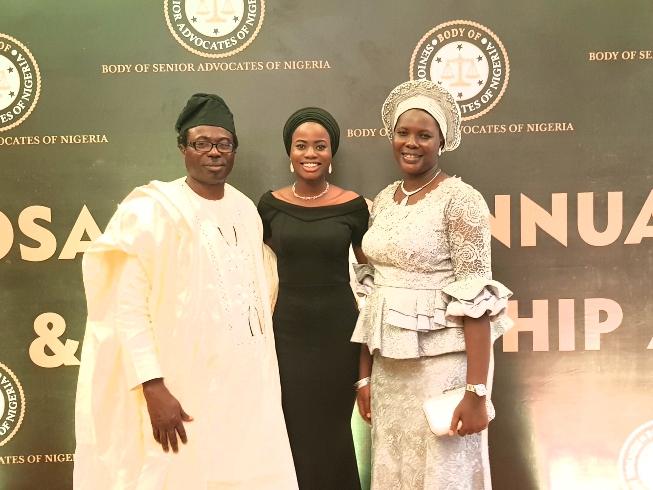 Bukola Fatima Alada, with her parents at BOSAN award