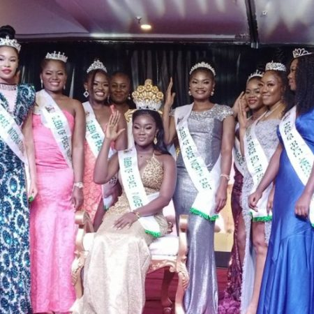 2021 Queen of Peace, Nigeria, Miss Ajuma Abah (fitted) surrounded by the other winners