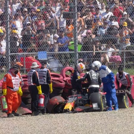 Max Verstappen being helped out of his crashed car at British Grand Prix