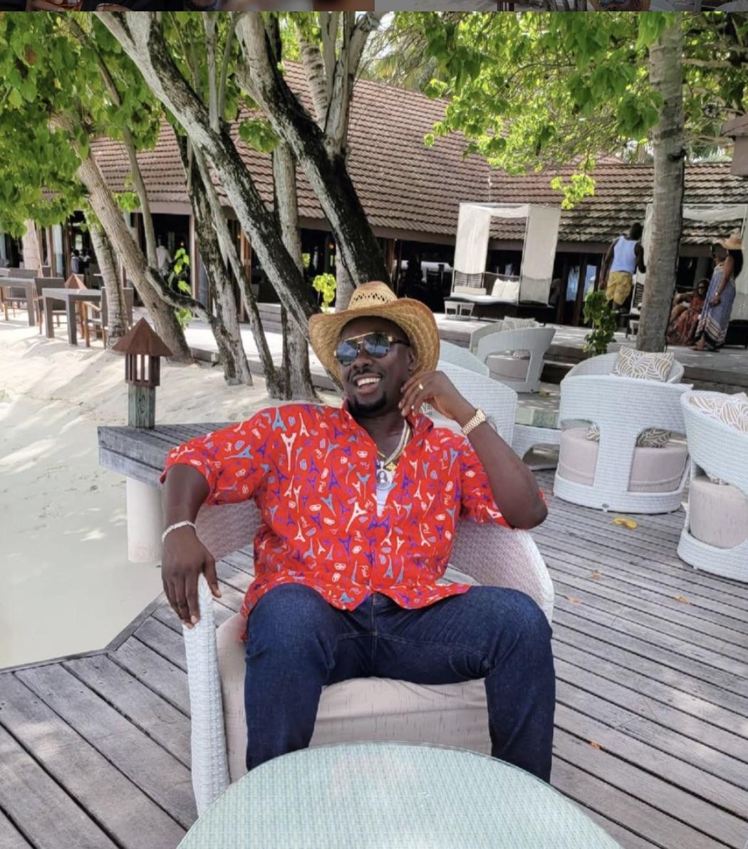 Obi Cubana at a lounge at the beach