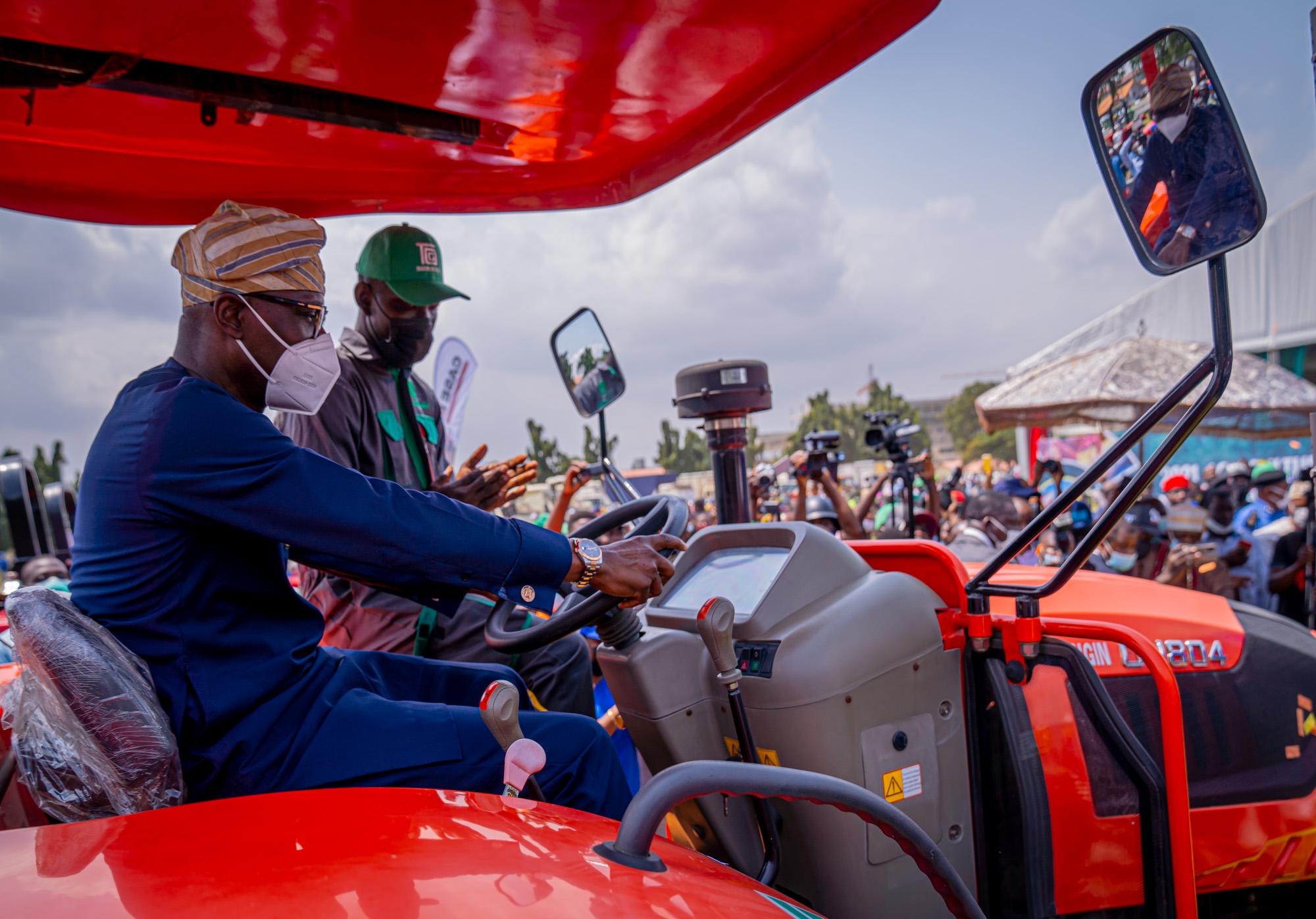 Sanwo-Olu driving a tractor