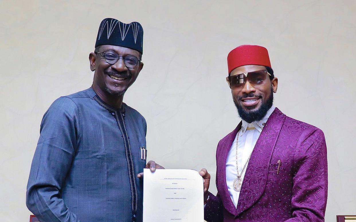 D'banj, right,  signs endorsement deal with Nigerian Export-Import Bank (NEXIM)