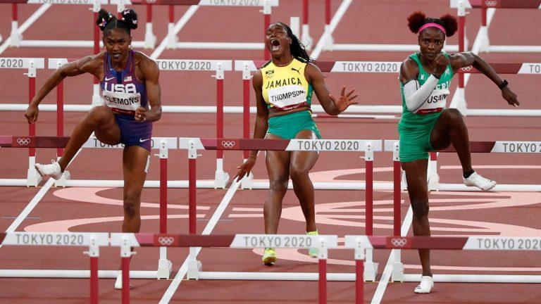 Amusan, right, breezes into 100m hurdles final