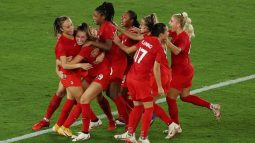 Canadian women rejoice after winning the gold medal in football