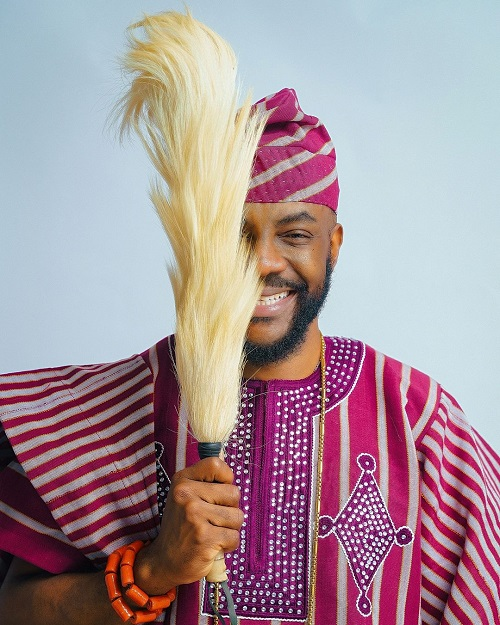 Ebuka poses with a Horsetail-fly-whisk known as 'Irukere' by the Yoruba people.