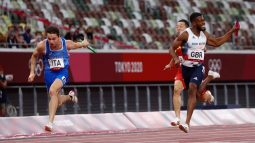 Filippo Tortu of Italy finishes ahead of Nethaneel Mitchell-Blake of Team GB