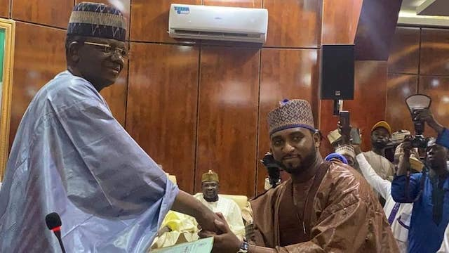 Governor Bello Matawalle congratules one of the new commissioners
