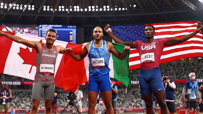 Jacobs of Italy, middle, win the Tokyo Olympics 100 metres gold