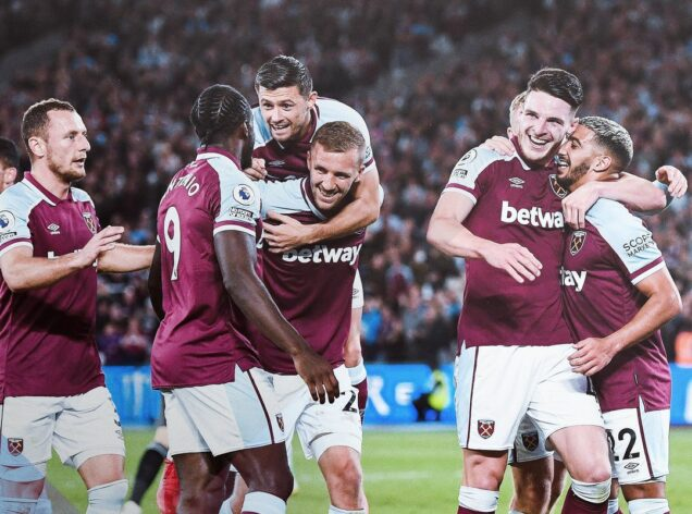 Michail Antonio, second left and teammates rejoice after West Ham thrash Leicester