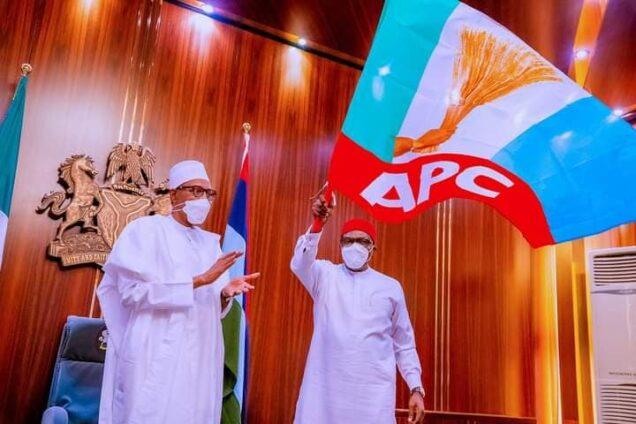 President Buhari after handing the APC flag to Senator Andy Uba