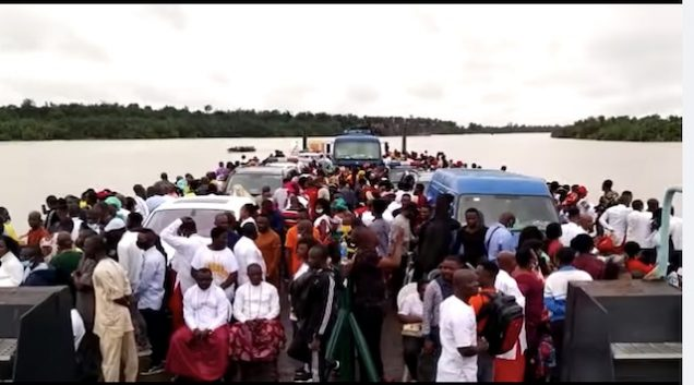 Scores of people on a barge heading to Ode Itsekiri for the coronation of Olu of Warri