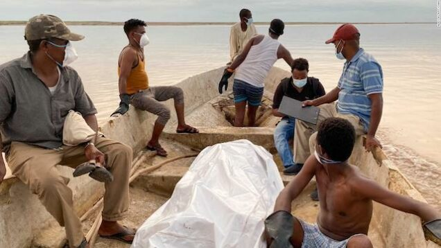 A body covered in plastic sheet after recovered from Setit Rive in Sudan