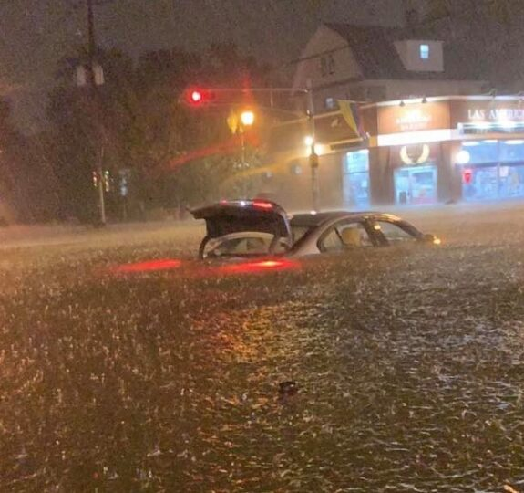A car trapped in a flooded road in New York City