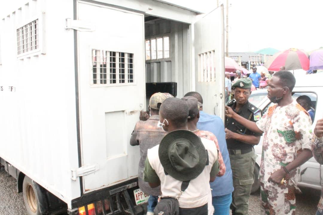 Beggars being hauled into Black Maria