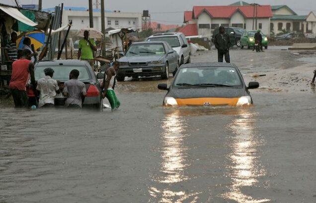 File: Flooded road in Benin in 2018