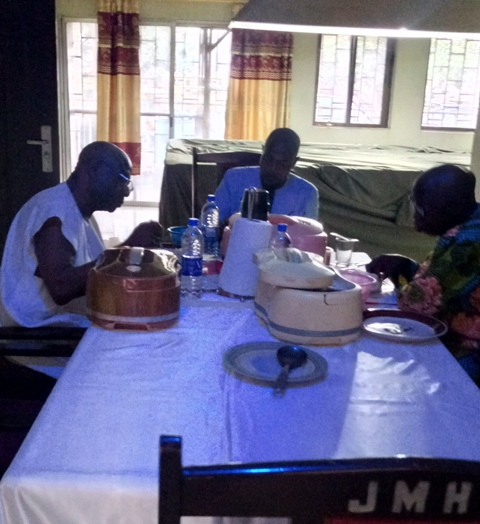 Gen Alabi-Isama dining with his visitors