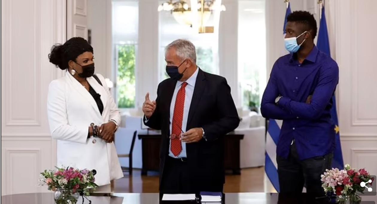 Greek Interior Minister Makis Voridis with Veronica Antetokounmpo and her son Emeka